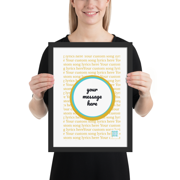 smiling woman holds print in black frame of sample custom self care song with lyrics and personalized message space