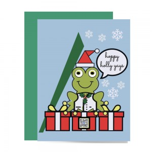 funny holiday card with illustration of smiling frog sitting atop wrapped Christmas presents and wearing Santa hat with mountains and snow around her; holly sprig on holiday vest. QR on gift box plays merry holiday song