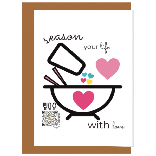 Season your life with love recycled paper singing greeting card seen with craft paper envelope behind it; illustration features bowl with heart in center being filled by salt shaker full of the word love and hearts pouring from it, qr code plays song